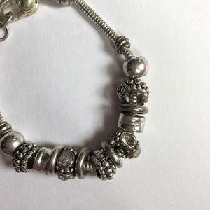 Silver charm bracelet similar to pandora